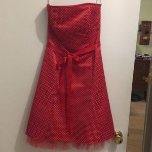 Red Jessica McClintock dress with polka dots.